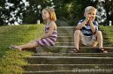 cute-young-boy-and-girl-sitting-on-steps-of-park-thumb11184797